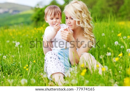Mother and child in nature - stock photo