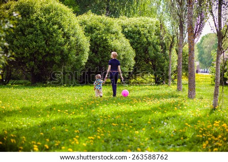 Mother and child in nature with balloon