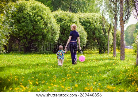 Mother and child in nature with balloon - stock photo