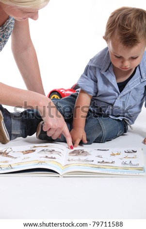 Mother and child looking at a book - stock photo