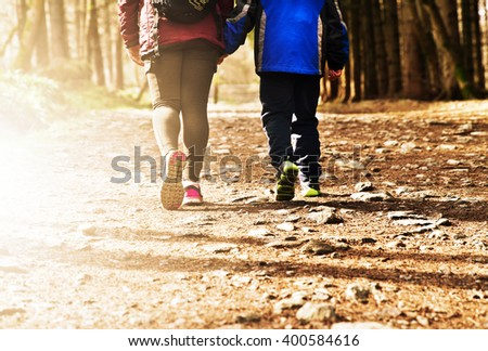 Mother and child morning walk off road in nature - stock photo