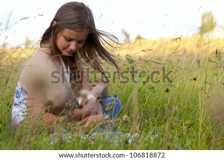 mother and child on a Summer field