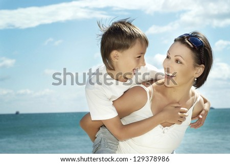 Mother and child on the background of the sea