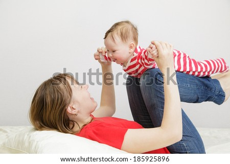 mother and child playing at home - stock photo