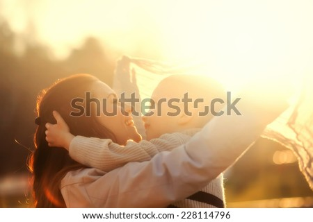 Mother and child playing in the park outdoor - stock photo