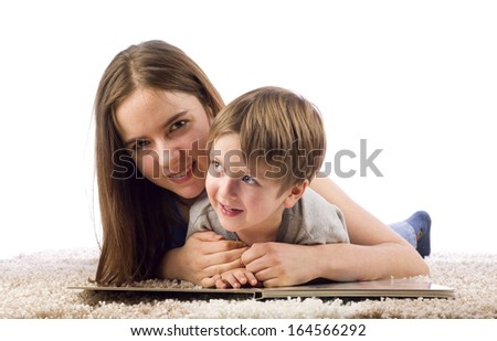 Mother and child reading book - stock photo