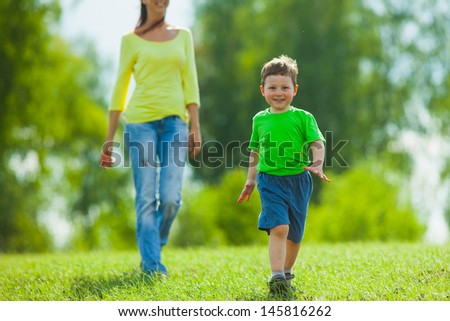 mother and child running across the field
