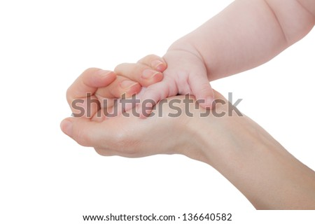 Mother and child's hands touch.