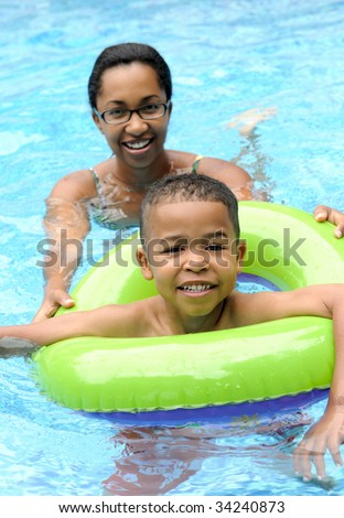 Mother and child swimming - stock photo