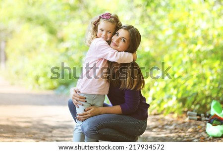 Mother and child walking in park - stock photo
