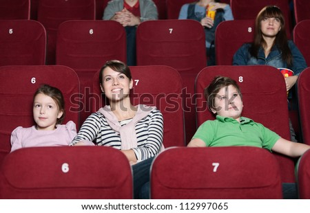 Mother and children are watching movie