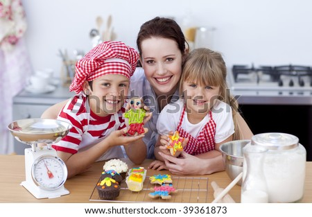Mother and children baking in the kitchen all together - stock photo