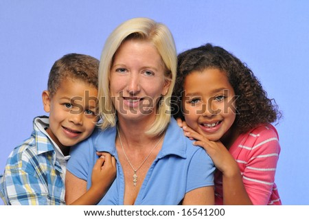 Mother and children portrait against a blue background - stock photo