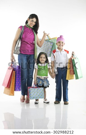 Mother and children with shopping bags