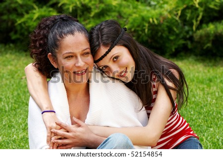 Mother and daughter against the nature