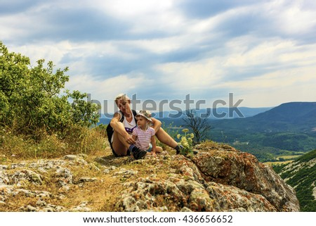 Mother and daughter at the edge of the abyss - stock photo