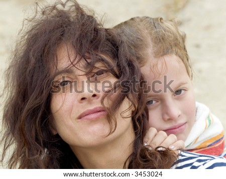 Mother and daughter at the sea