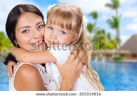 Mother and daughter. Brunette and blonde - stock photo