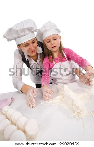 Mother and  daughter cooking  together isolated on white. - stock photo