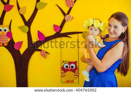 mother and daughter doing a photo shoot - stock photo