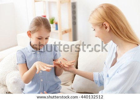 Mother and daughter doing manicure