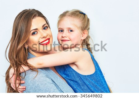 Mother and daughter embrace. Smiling and happy woman with little girl. - stock photo