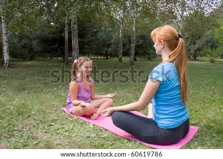 mother and daughter engage in fitness