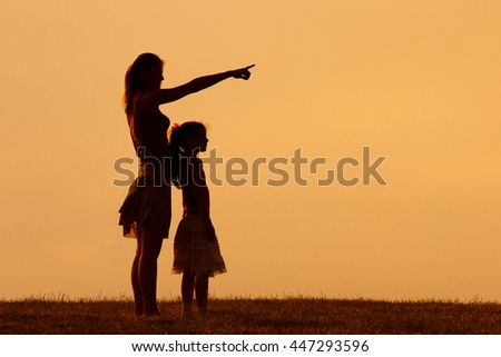 Mother and daughter enjoy spending time together in nature.Precious family moments - stock photo