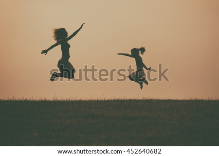 Mother and daughter enjoy spending time together outdoor.Precious family moments Image is intentionally with grain and toned. - stock photo
