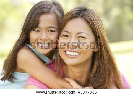 Mother And Daughter Enjoying Day In Park - stock photo