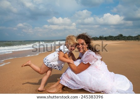 mother and daughter enjoying time at sandy beach