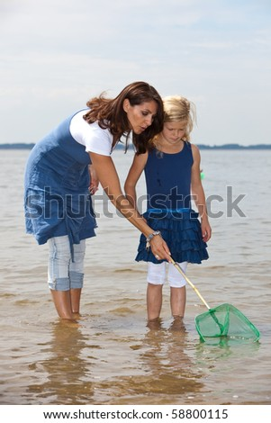 Mother and daughter fishing in the sea