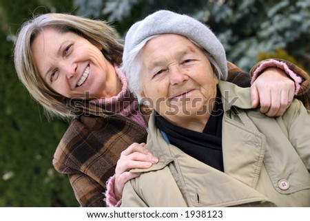 Mother and daughter. Focus on the younger person. - stock photo