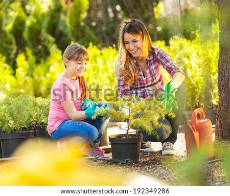 Mother and daughter gardening together.Family concept. - stock photo