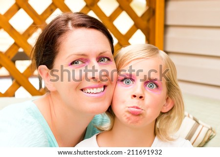 Mother and Daughter Goofing Around for the Camera - stock photo