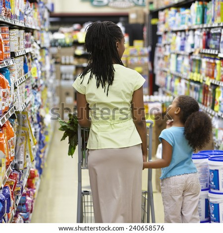 Mother and Daughter Grocery Shopping - stock photo
