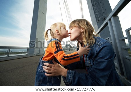 mother and daughter have a good time in the city - stock photo