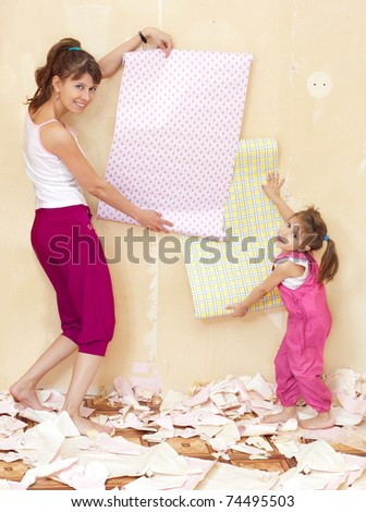 Mother and daughter have fun doing repairs - stock photo