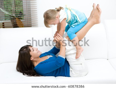 mother and daughter having fun at home - stock photo