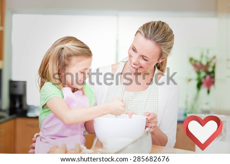 Mother and daughter having fun in the kitchen against heart - stock photo