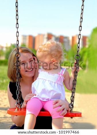 Mother and daughter having fun in the park - stock photo