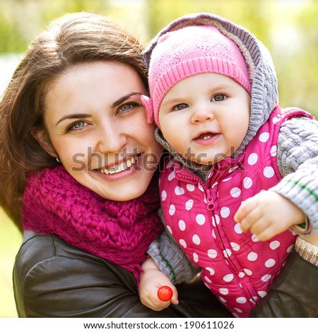 Mother and daughter having fun in the park. Mothers Day. - stock photo