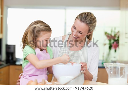 Mother and daughter having fun together in the kitchen