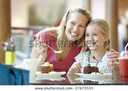 Mother And Daughter Having Lunch Together At The Mall - stock photo