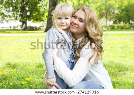 Mother and daughter hug. Mothers day celebration concept - stock photo
