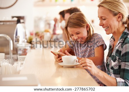 Mother and daughter in a cafe - stock photo