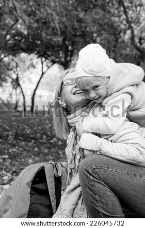 Mother and daughter in a garden - stock photo
