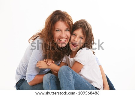 Mother and daughter in a loving pose isolated on a white background. - stock photo