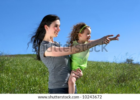 Mother and daughter in a meadow - stock photo
