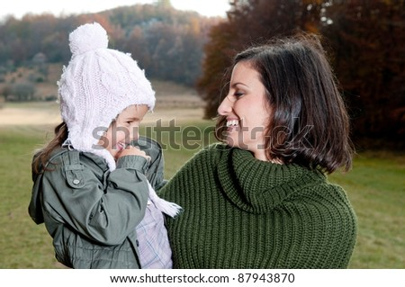Mother and daughter in nature - stock photo